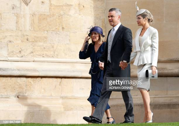 British singersongwriter Robbie Williams arrives with his wife US actress Ayda Field to attend the wedding of Britain's Princess Eugenie of York to...