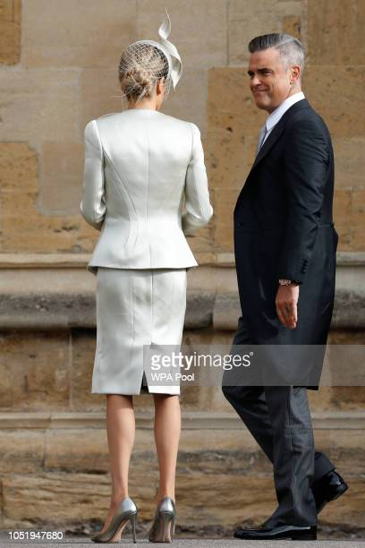 British singersongwriter Robbie Williams arrives with his wife US actress Ayda Field ahead of the wedding of Princess Eugenie of York and Mr Jack...