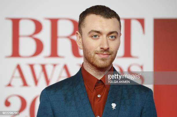 British singer-songwriter Sam Smith poses on the red carpet on arrival for the BRIT Awards 2018 in London on February 21, 2018. / AFP PHOTO / Tolga...