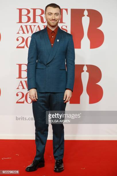 British singersongwriter Sam Smith poses on the red carpet on arrival for the BRIT Awards 2018 in London on February 21 2018 / AFP PHOTO / Tolga...