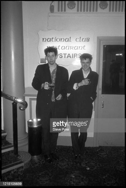 British singersongwriter Shane MacGowan and British tin whistle player and singer Spider Stacy drinking at the National Ballroom in Kilburn London...