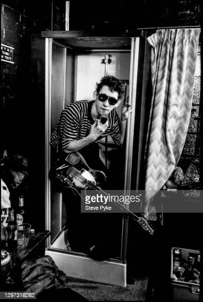 British singer-songwriter ,Shane MacGowan, 'rehearsing' in the shower backstage at the Town & Country Club, where The Pogues were performing on St...