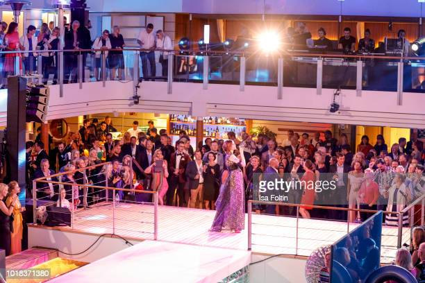 Models walk the runway during the FASHION2NIGHT event on board the EUROPA 2 on August 17 2018 in Hamburg Germany