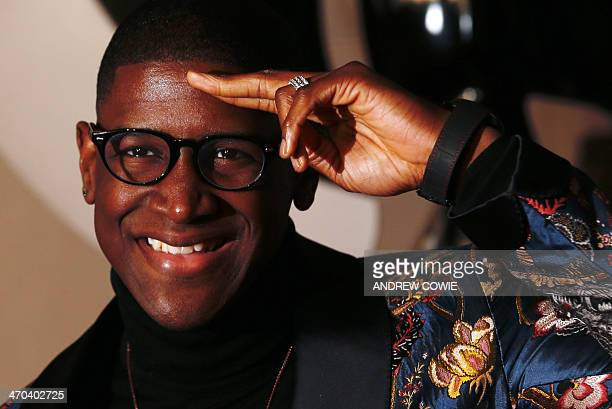 British singersongwriter Timothy McKenzie better known by his stage name Labrinth poses on the red carpet arriving at the BRIT Awards 2014 in London...