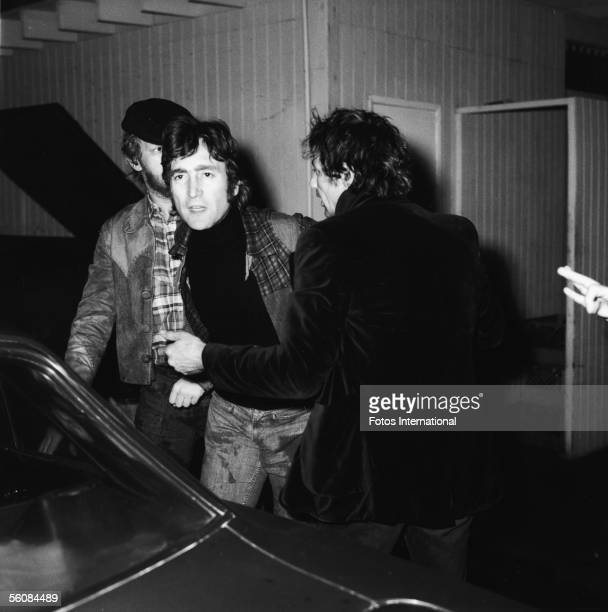 British singer-songwriter-musician John Lennon is held back from attacking a photographer by American singer-songwriter-musician Harry Nilsson and an...