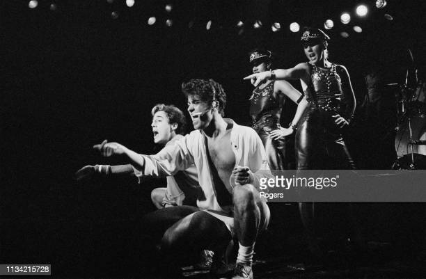 British singersongwriters George Michael and Andrew Ridgeley of pop duo Wham performing at the Lyceum Theatre during the Club Fantastic Tour London...