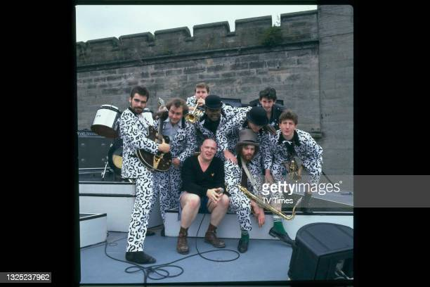British ska group Bad Manners, including singer Buster Bloodvessel , photographed on stage before a live performance circa 1982.