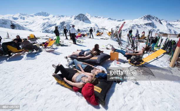British ski chalet hosts enjoying the spring sunshine on April 3 2017 in Val D'Isere France Thousands of British tourists have headed for the late...
