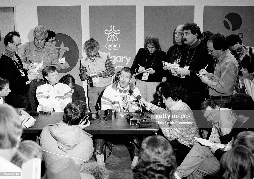 British ski jumper, Eddie 'The Eagle' Edwards (seated centre), speaking during a media conference at the Winter Olympic Games in Calgary, Canada, 11th February 1988.
