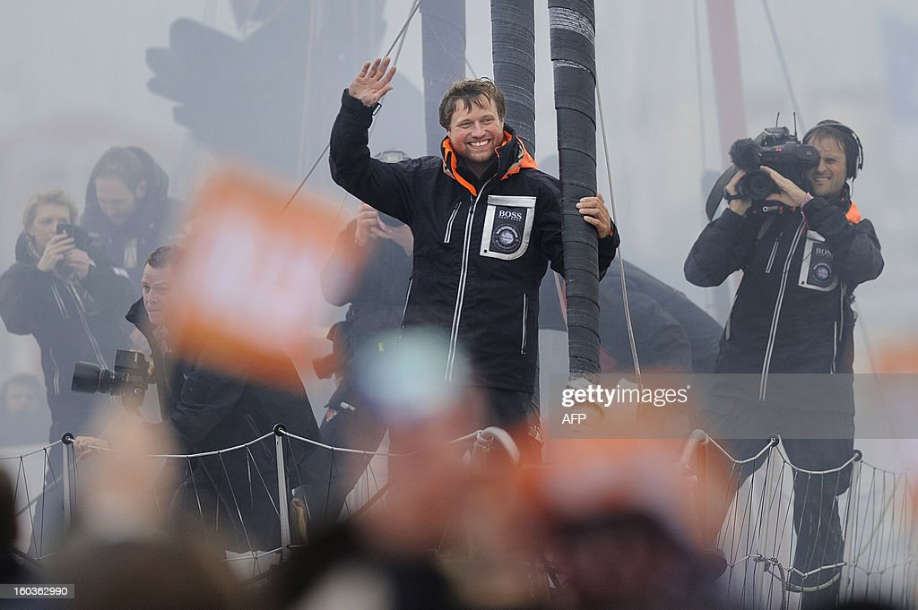 British skipper Alex Thomson celebrates on his monohull 'Hugo Boss' after placing third in the 7th edition of the Vendee Globe solo round-the-world race on January 30, 2013 in Les Sables d'Olonne, western France.