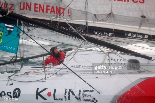 British skipper Samantha Davies aboard her Imoca monohull initiatives Coeur sails off the coast of SaintMalo on November 4 2018 moments after taking...
