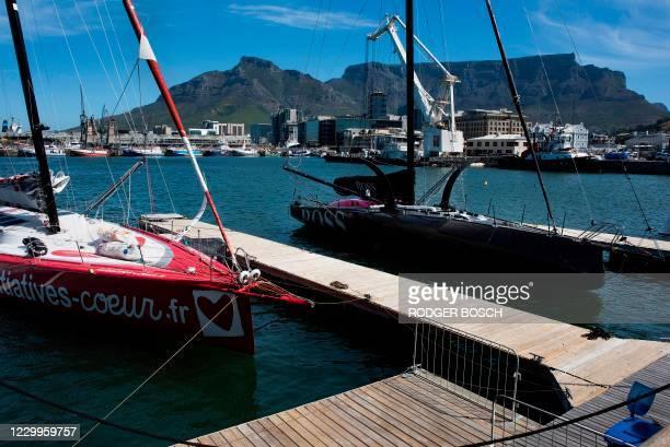 British skipper Samantha Davies' Imoca 60 Initiative Coeur and British skipper Alex Thomson's Imoca 60 Hugo Boss are moored at Cape Town Harbour on...