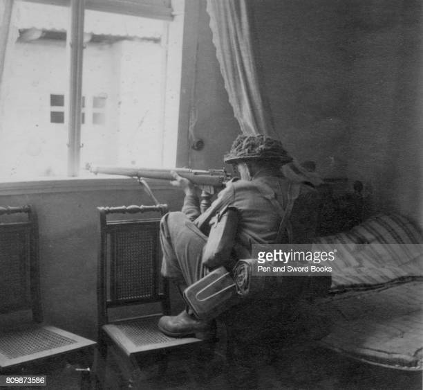 British sniper in a house on the right bank of the rhine in Rees Germany