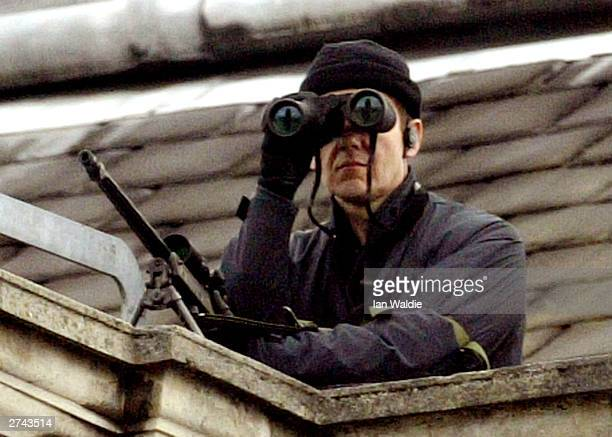 British sniper protecting US President George W Bush scans the streets as Bush arrives at Banqueting House November 19 2003 in central London England...