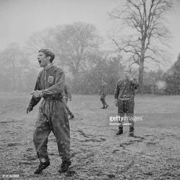 British soccer player Alan Ball Jr training under the snow with the England team under the supervision of soccer manager Alf Ramsey UK 3rd April 1968