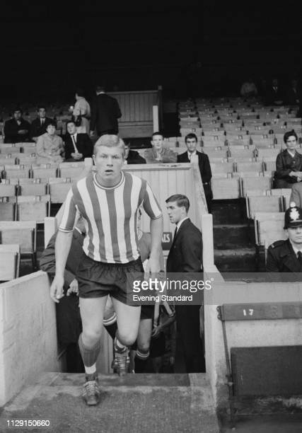 British soccer player and midfielder Keith Hooker of Brentford FC taking the field, UK, 6th August 1968.