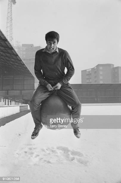 British soccer player and striker Geoff Hurst of West Ham United FC trying a bouncing ball on a snowy pitch London UK 13th January 1968