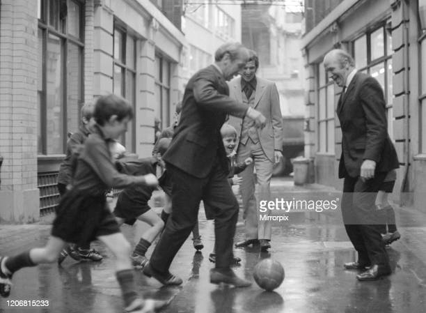 British soccer player Bobby Charlton is chased in the street by children of Dounside Purley School in Surrey watched by England manager Sir Matt...