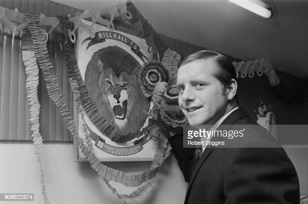 British soccer player Harry Cripps decorating the Millwall FC's Lion, London, UK, 20th December 1968.