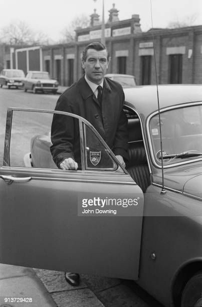 British soccer player Johnny Haynes of Fulham FC getting on a car London UK 22nd January 1968
