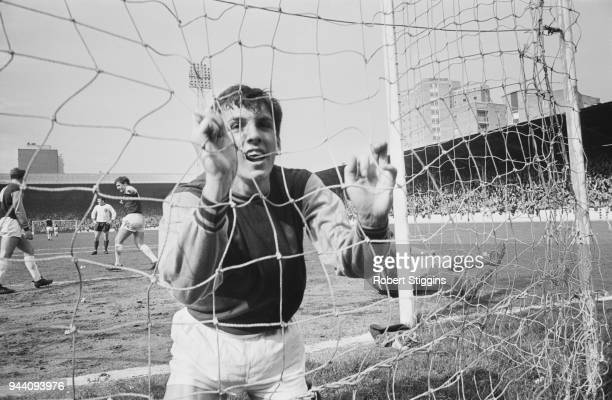 British soccer player Martin Peters of West Ham United FC in the back of the net after scoring against Liverpool UK 22nd April 1968