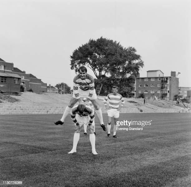 British soccer player of Queens Park Rangers FC Rodney Marsh and Frank Clarke playing leapfrog at Loftus Road Stadium, UK, 9th August 1968.