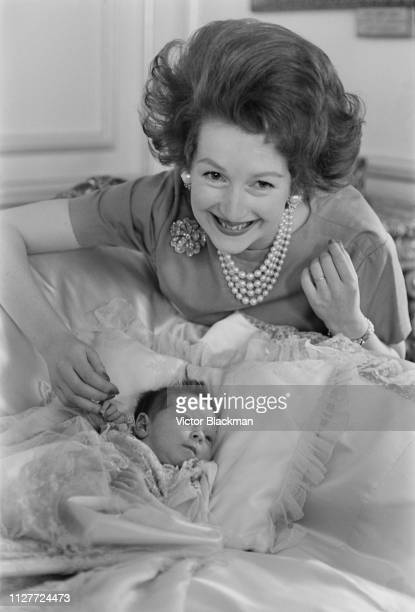 British socialite and local politician Raine Spencer Countess Spencer with her baby daughter Lady Charlotte Legge UK 9th August 1963