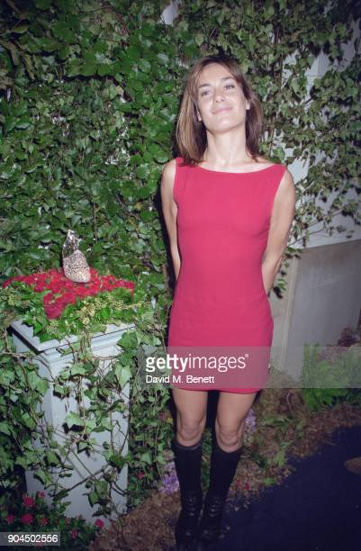 British socialite and television personality Tara PalmerTomkinson wearing red mini dress and kneehigh boots at the 'Ever After A Cinderella Story'...