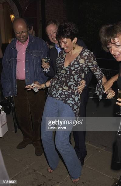 British socialite Ghislaine Maxwell and British editor Geordie Greig attend the 40th birthday party for Annabell's on September 16 2003 in London
