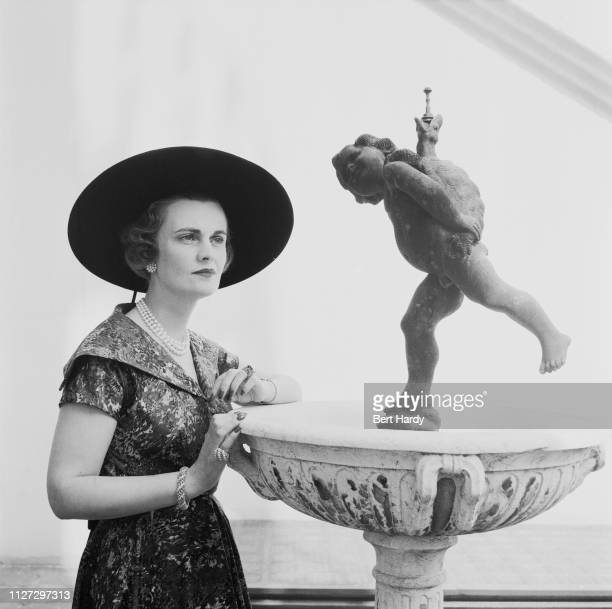 British socialite Margaret Campbell Duchess of Argyll wearing printed dress and Gainsborough hat UK 6th August 1955 Original Publication Picture Post...