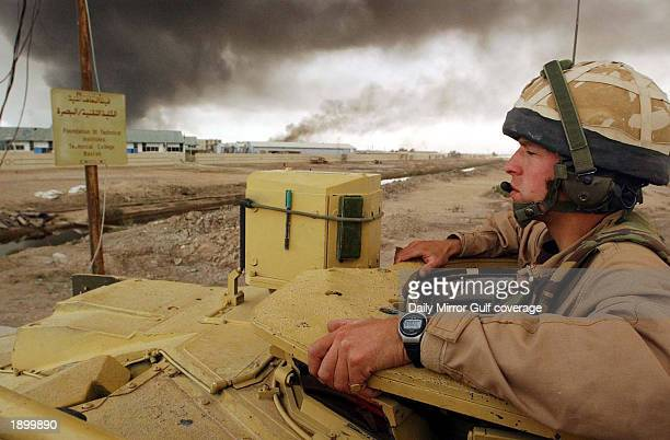British soldier Alex Matheson of the Royal Scots Dragoon Guards the 7th Armoured Brigade 'The Desert Rats' drives a Challenger ll tank April 4 2003...