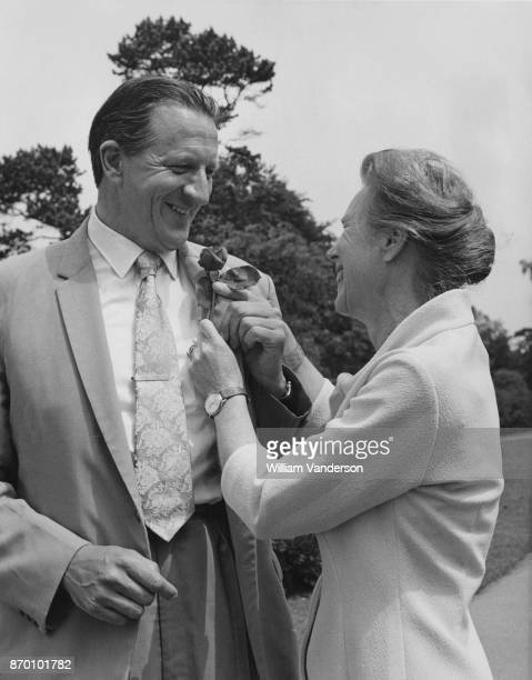 British soldier and botanist Jack HeslopHarrison receives a rose in his buttonhole from his wife Yolande in his first week as Director of the Royal...