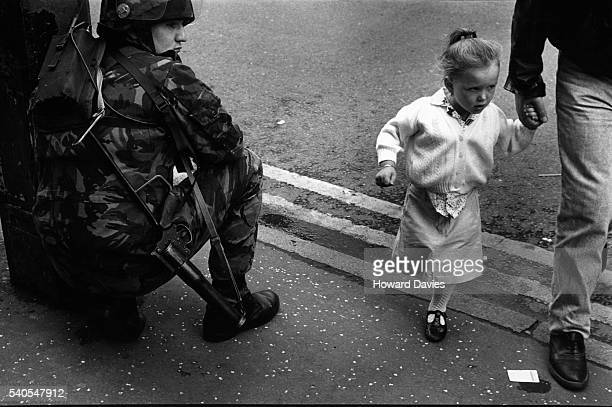 british soldier and little girl - falls road stock pictures, royalty-free photos & images