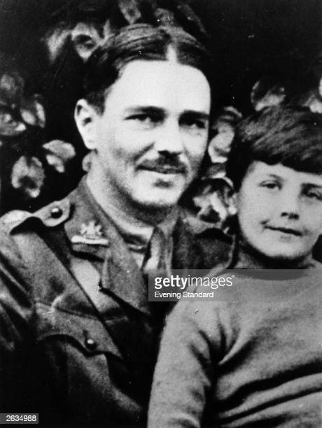 British soldier and war poet Wilfred Owen in uniform with a young boy, circa 1917.