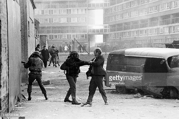 A British soldier apprehends a civilian during rioting near the Rossville Flats in the Bogside area of Derry/Londonderry Northern Ireland on Bloody...