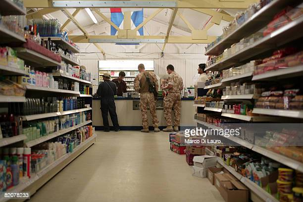 British soldier buys goods at the NAFI shop at British Army base Task Force Helmand Headquarter on July 23 2008 in Lashkar Gah Helmand Province...