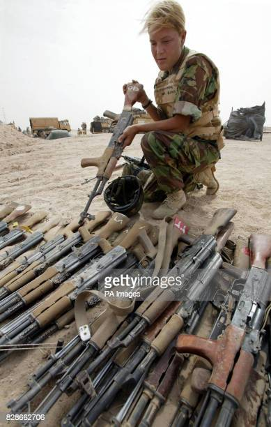 A British soldier examines Iraqi AK47 assault rifles soon to be destroyed at a base near Basra Iraq PA Photo/Guardian/Dan Chung/MoD POOL