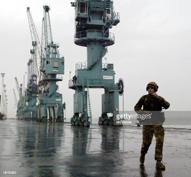 British soldier from 42 Commando Brigade stands guard at the new port March 25 2003 in Umm Qasr Iraq The port town on the KuwaitIraq border was...