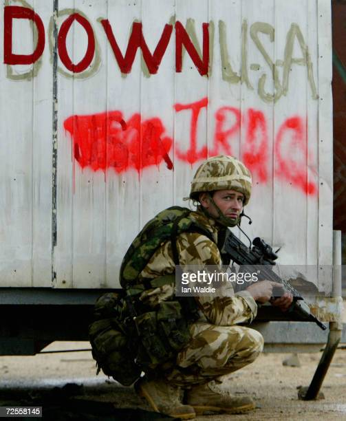 British soldier from 42 Commando stands guard at the old port March 25 2003 in Umm Qasr Iraq The port town on the KuwaitIraq border was secured by...