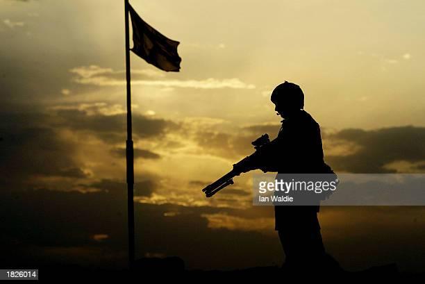 British soldier from 7 Air Assault Brigade stands guard at Camp Eagle March 3 near Kuwait City, Kuwait. Iraq has threatened to halt the destruction...