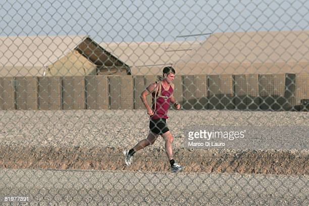 British soldier from the 13th Air Assault Support Regiment Lance Cpl Stuart McGregor from Stirling jogs prior an operation to deliver supplies to...