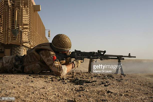 British soldier from the 13th Air Assault Support Regiment Sgt Major Neil Fraser from Glasgow tests his machine gun prior to an operation to deliver...