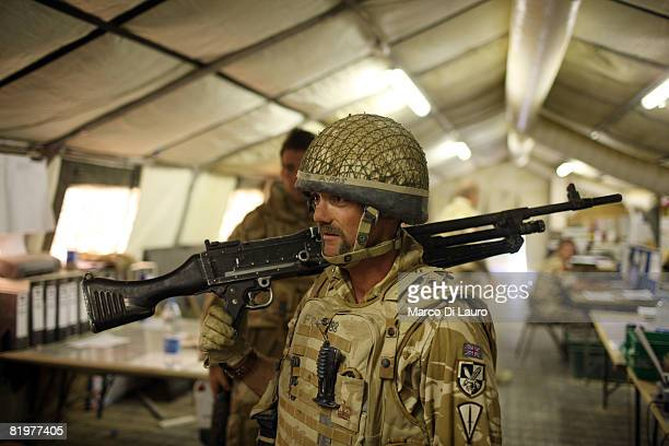 British soldier from the 13th Air Assault Support Regiment Sgt Major Neil Fraser from Glasgow holds his weapong after taking part in the test firing...