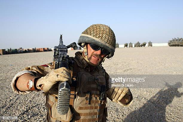 British soldier from the 13th Air Assault Support Regiment Sgt Major Neil Fraser from Glasgow takes part in the test firing of machine guns prior to...