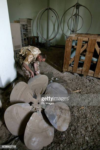 A British soldier from the REME examines items found at a building believed to have been used by 'Chemical Ali' in Basra Iraq PA Photo/Guardian/Dan...