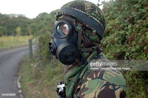 British soldier in full NBC protection gear and a S6 respirator.