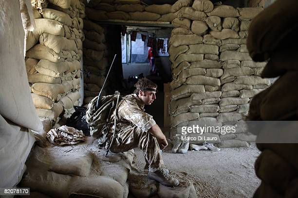 British soldier is on duty at Forward Operating Base Sangin Dc on July 22, 2008 in Sangin Dc, Helmand Province, Afghanistan. Lashkar Gah British army...