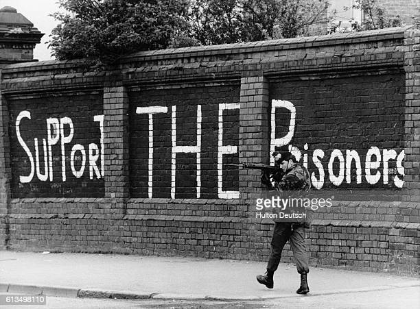 A British soldier keeps watch for snipers during a period of increased violence following the death of hunger striker Bobby Sands