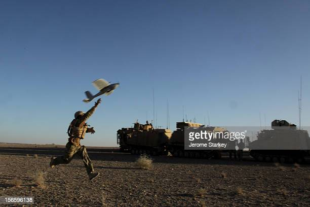 British soldier launches an unmanned aerial vehicle , or drone, as part of a surveillance mission in central Helmand, during Operation Omid IV, a...