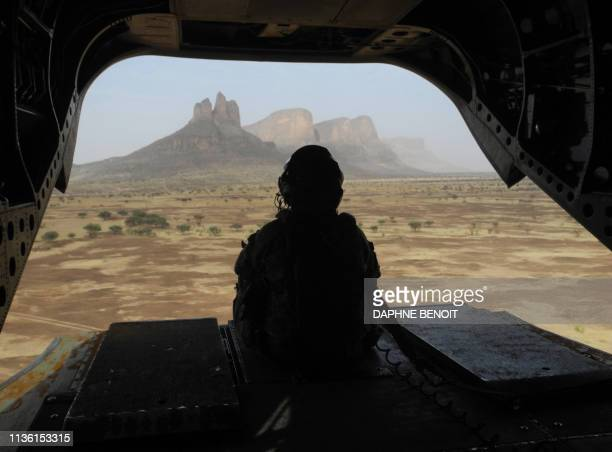 British soldier leaves the Hombori area aboard a Chinook helicopter on March 28 2019 during the start of the French Barkhane Force operation in...